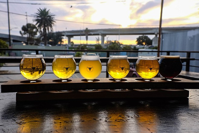 The view from Alta Brewing, including a flight of its beers