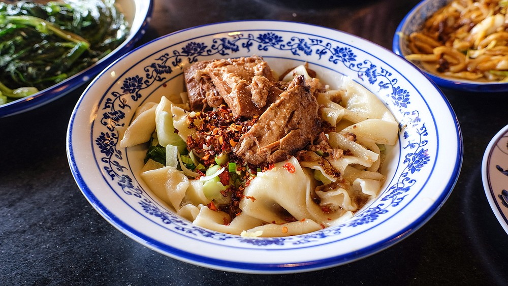 Hand-ripped noodles with stewed pork