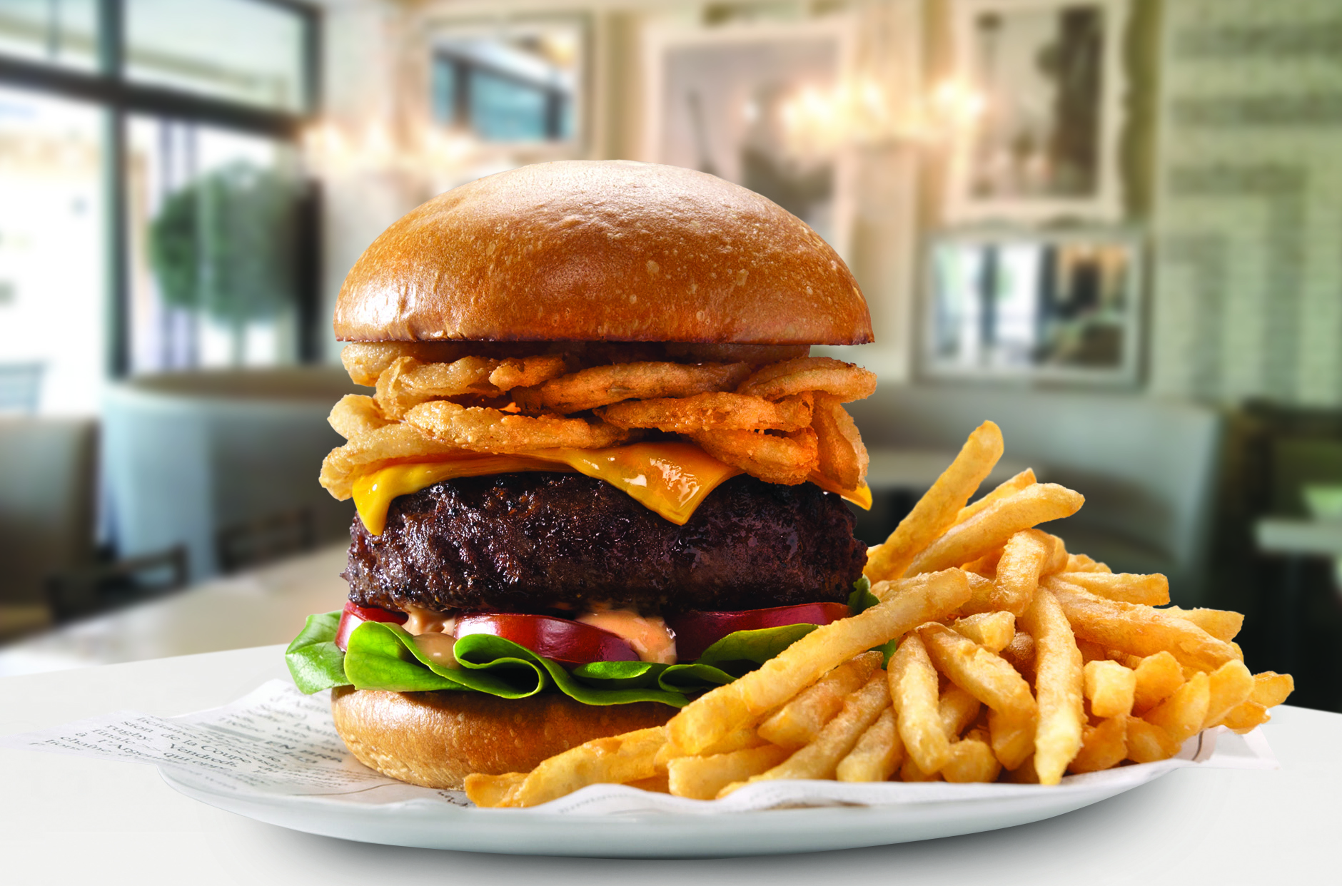 The Sugar Factory Burger at the Theatre Box comes with a half-pound of Angus beef, crispy onions on a brioche bun.