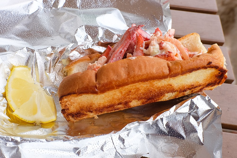 A Maine style lobster roll, tossed in mayo with lemon and melted butter on the side