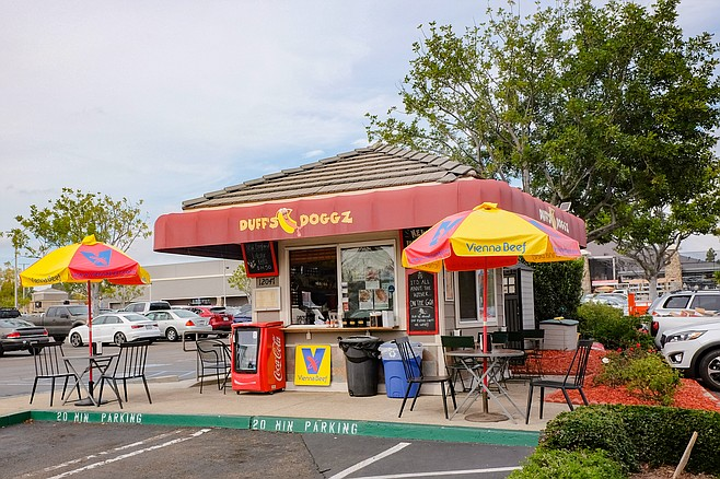 A Chicago style hot dog shack in a Home Depot parking lot