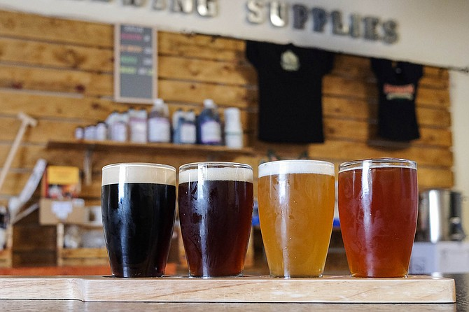 An Embarcadero Brewing flight: nitro stout, coffee brown ale, golden ale, and strawberry blonde.