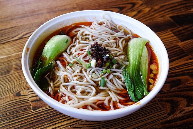 The red broth containing these noodles is not as flavorful and spicy as it looks.