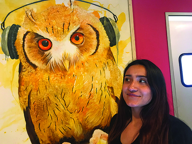 Aubri, and her front desk friend, owl by Paco