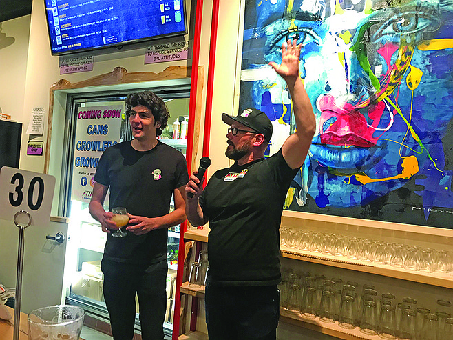 """Kurt, with his Brazilian brewer Alvaro, responds to crowd. Paco's $4,400 """"Quetzal Urbana"""" painting shows a brewpub can also be a gallery"""
