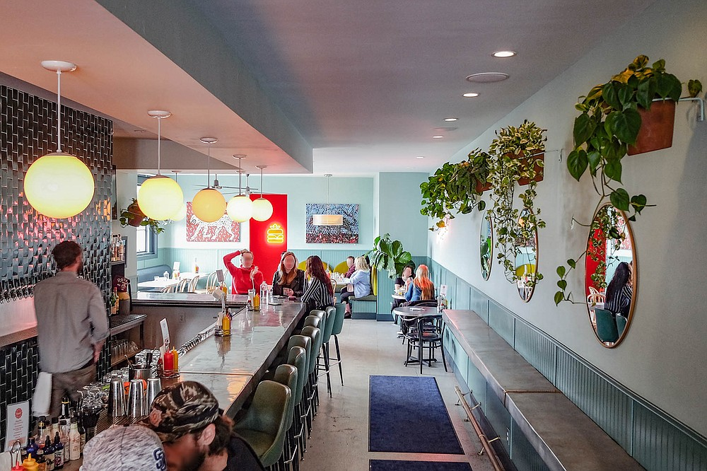 Bright family friendly restaurant for brunch, a stylish cocktail scene at night