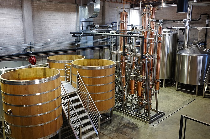 The Storyhouse Spirits distiller, from left to right: oak foedres, a continuous copper still, and stainless steel mash tun.