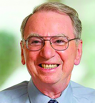 Irwin Jacobs is smiling, despite not getting his Balboa Park parking garage, because he's still super rich.