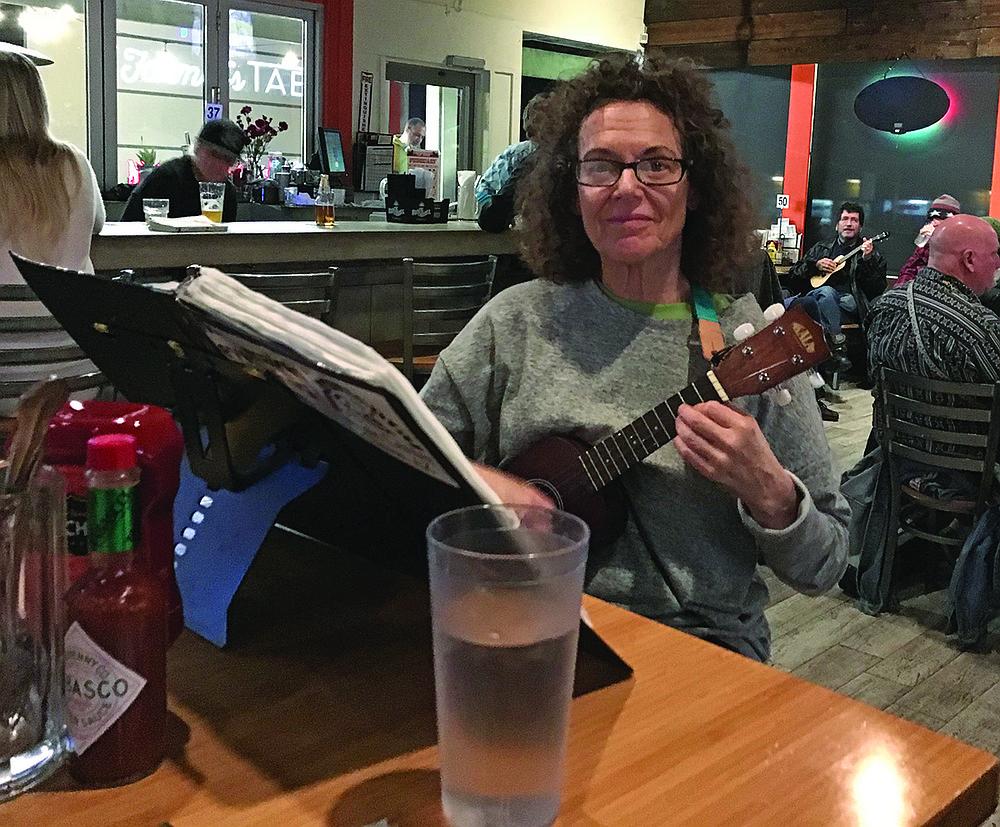 Judith Garfield, plays uke when she's not underwater