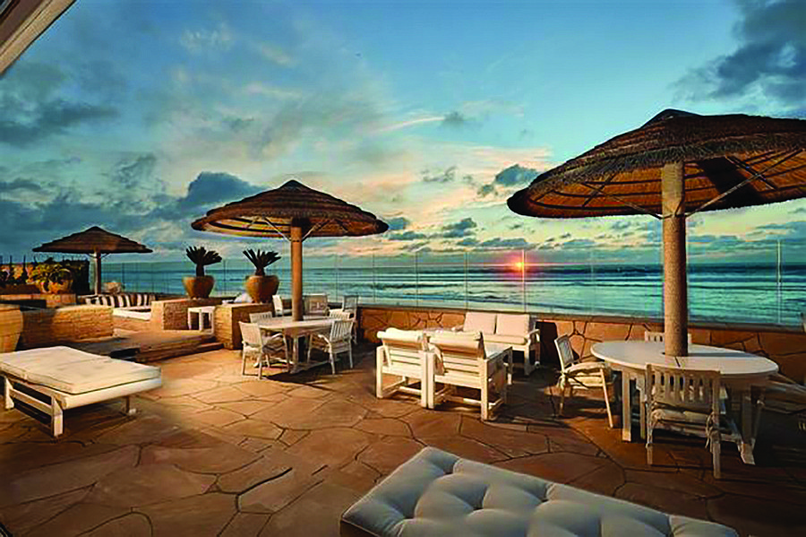 The patio overlooks 120 feet of direct ocean frontage.