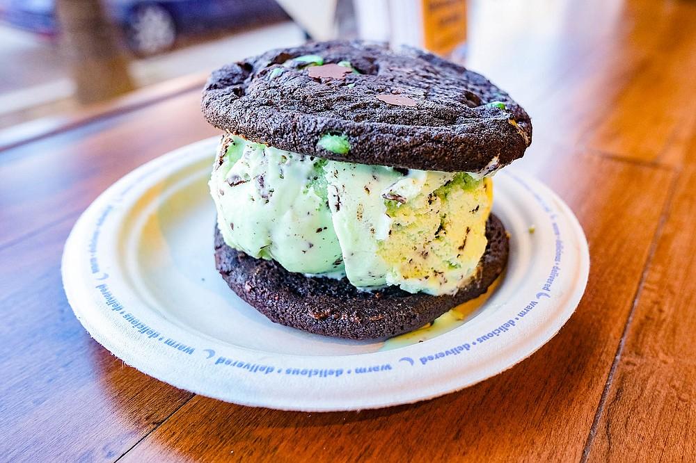 Ice cream sandwich with double chocolate chunk cookie, double chocolate mint cookie, and mint chocolate chip ice cream