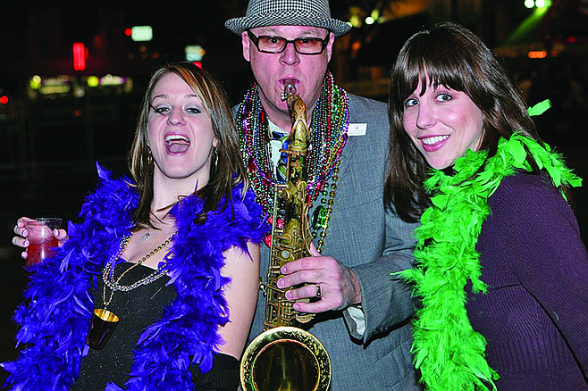 Boas, beads and bari sax at Mardi Gras!