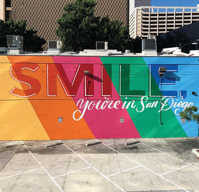 Phoebe Cornog is the creator of the Smile mural which is located on a large parking lot wall north of Broadway on First Avenue.