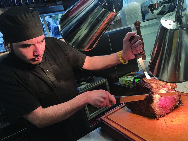 David cuts into the roast beef