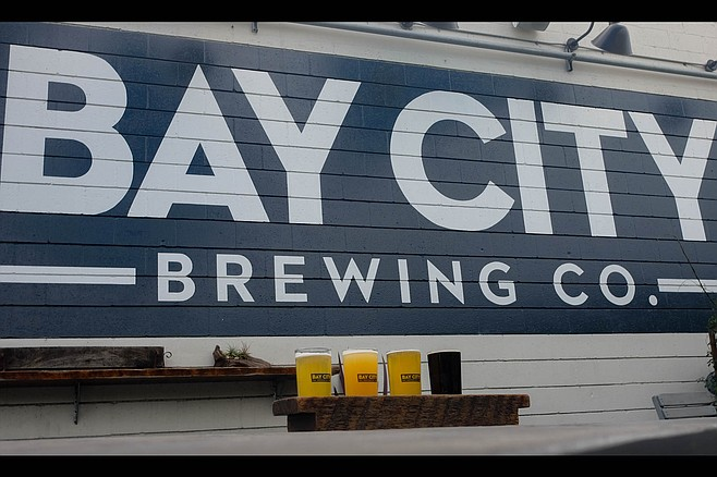 A flight on the patio of Bay City Brewing