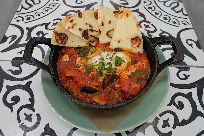 The traditional North African dish, shakshouka: poached egg in a stew of tomatoes and chili peppers