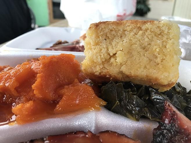 Candied yams, collard greens, and cornbread