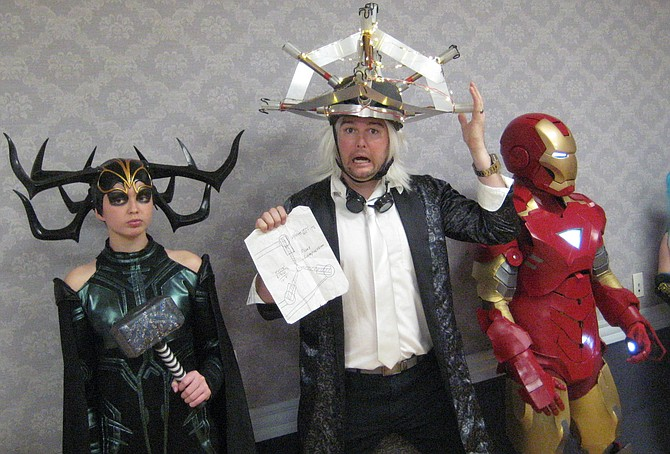"Rocket Con 2019: Hela from Thor comic books, ""Doc"" Brown from Back to the Future, and Iron Man from Marvel Comics."