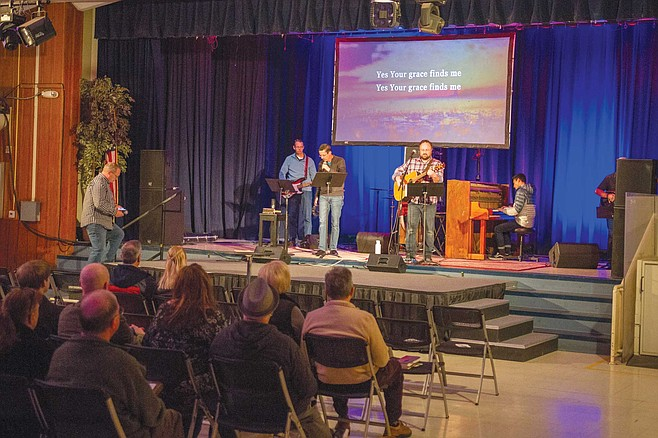 """Legacy Church in La Mesa does not use old-fashioned hymnals any longer. """"We sing off of screens where the words are projected, and we have a wide variety of musical instruments."""""""