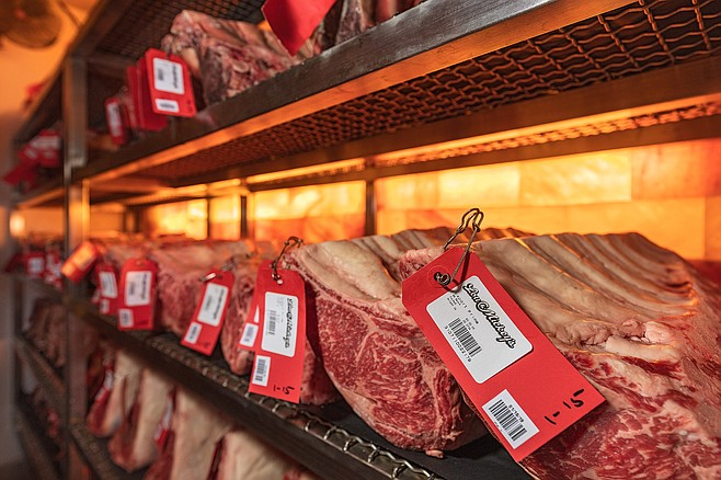 Primal cuts of beef spending time in climate controlled dry aging room