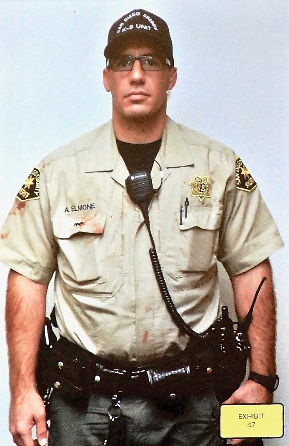 Deputy Elmone had blood from his dog on his uniform, after he carried the dog away.