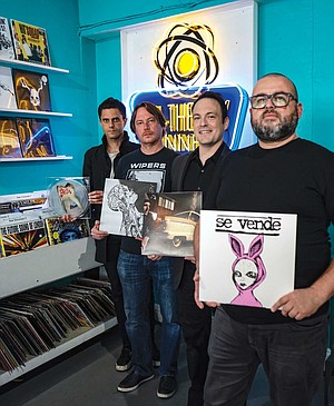 Four local rockers launched their own record labels to release vinyl by local and international artists. Pictured at M-Theory Music (which has entire bins dedicated to specific local labels) are, from left, Justin Pearson of Three One G Records, Craig Oliver of Volar Records, Brian Witkin of Pacific Records and Will Castro of La Escalera Records.