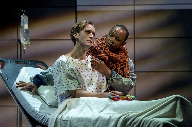 Belize (Kevane La'Marr Coleman) comforts Prior (Alex Bodine), who has just been diagnosed with AIDS.