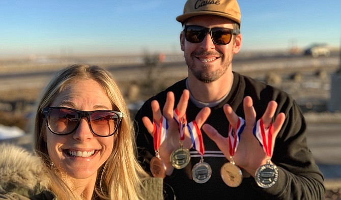 Suzanna and Billy Beltz show off the five medals they earned in March at the Mazer Cup International Mead Competition