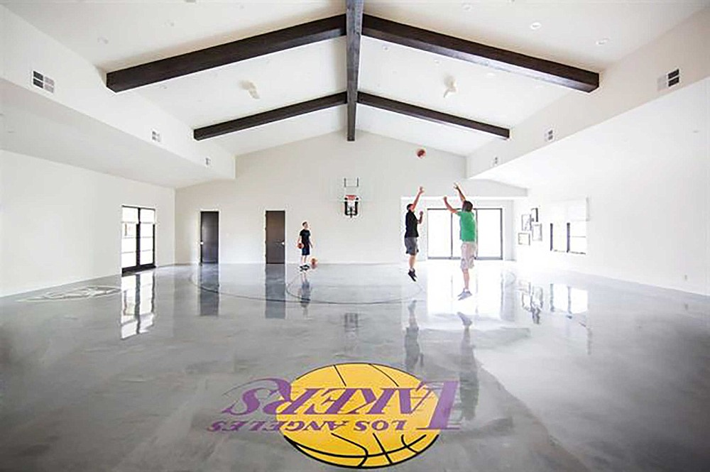 Forget a hoop above the garage with Run of the Knolls' full-sized indoor court