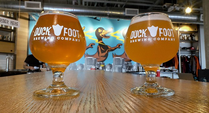 Beers and a wall of lightning spewing ducks at the Duck Foot tasting room