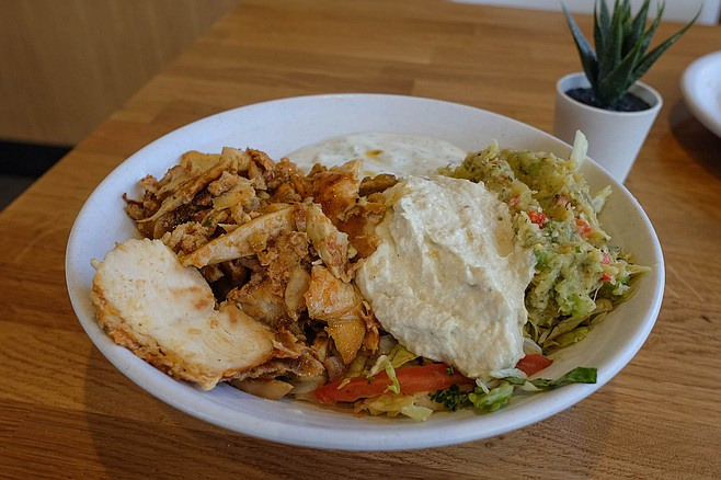 A chicken shawarma bowl served over brown basmati rice with cucumbe yogurt (moutabel and baba ghanoush added for a dollar each)