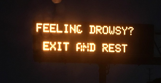 Does this sign encourage over-nighters?