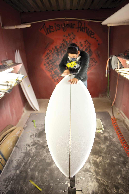 Mario Medel of Mars Surfboardsin his Ensenada shaping room.