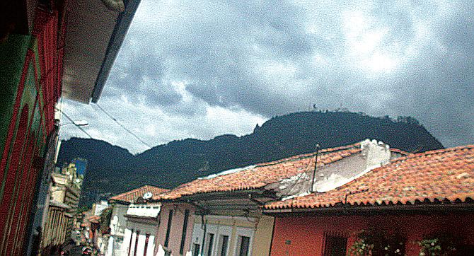 The sun finally emerges over a Bogota street.