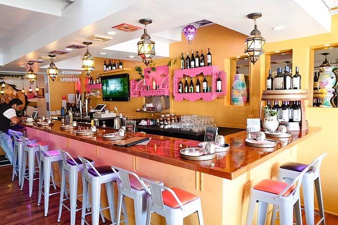 A colorful bar space anchors Curryosity.