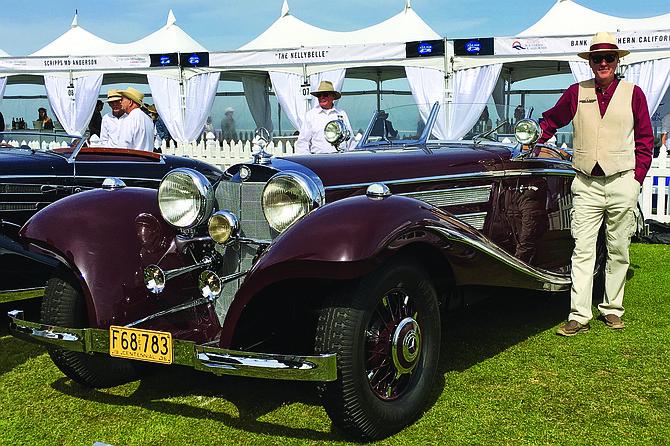 Craig Hopkins and his burgundy Benz.