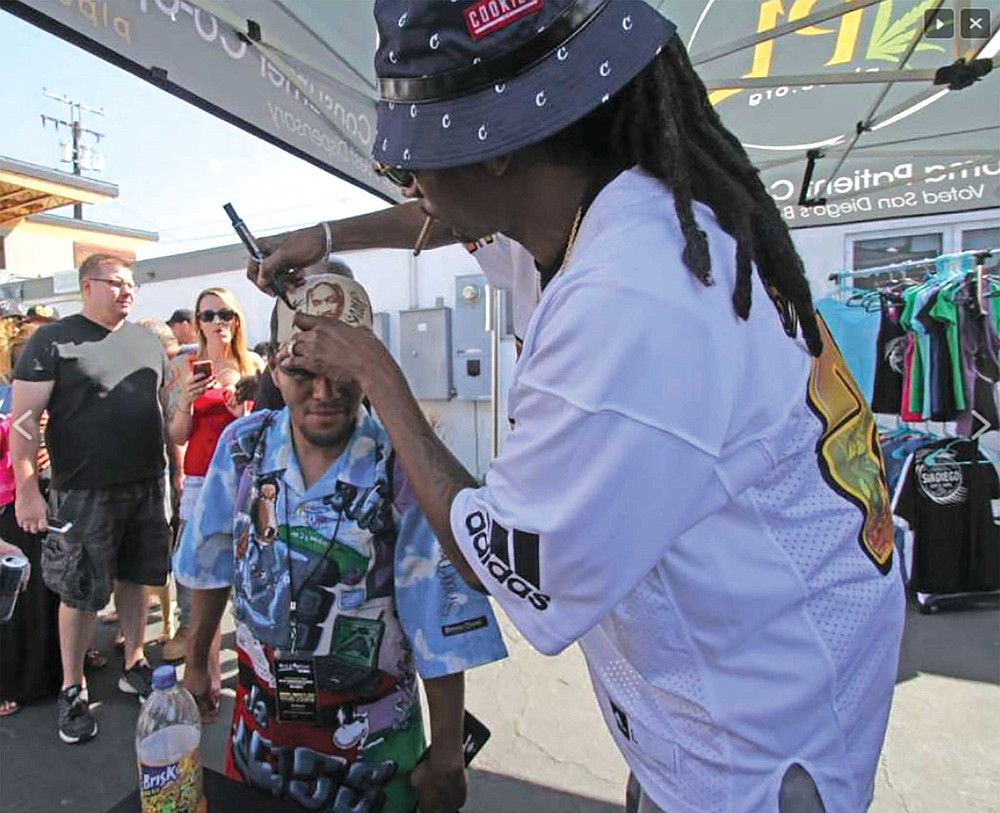 """Snoop was stoked when he saw Z's get-up and he signed his hat and the shirt on his back and took a photo with him. """"I've been wanting to meet him for a long long time,"""" Z-MAN said."""