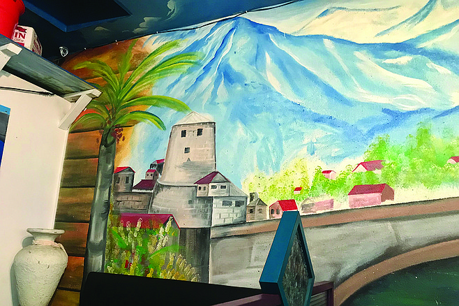 Memories of home: The legendary bridge at Mostar, a mural on Arslan's wall