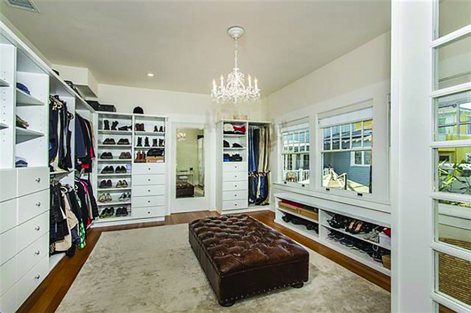 Square footage is nice, but what really makes a master closet a master closet is a chandelier.