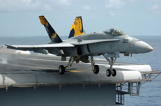 "F/A-18 Hornet. ""Work delayed on other F/A-18 aircraft because there were not enough...engineers and artisans, support equipment, and facilities."""