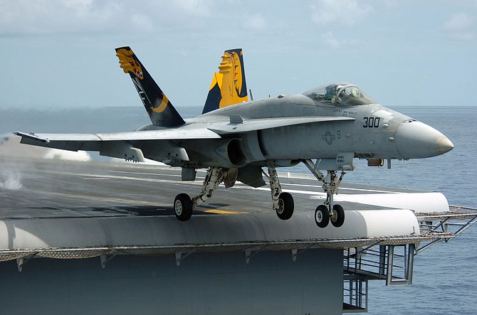 """F/A-18 Hornet. """"Work delayed on other F/A-18 aircraft because there were not enough...engineers and artisans, support equipment, and facilities."""""""