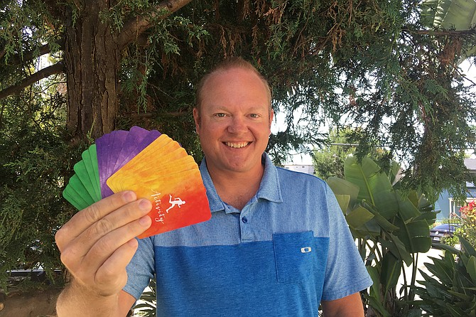 Pocket positivity: Jeff Holland and his Coping Cards.