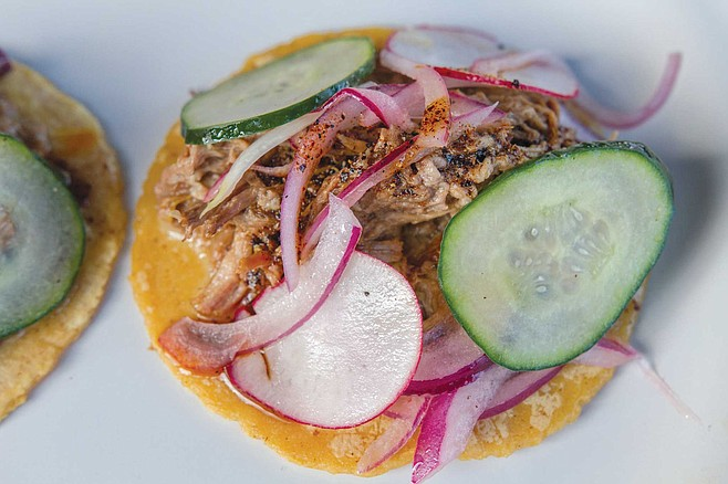 Cine Tonalá has five choices of tacos. The braised beef rib features a mound of shredded beef ribs on top of refried beans with pickled radishes, cucumbers, and red onions.