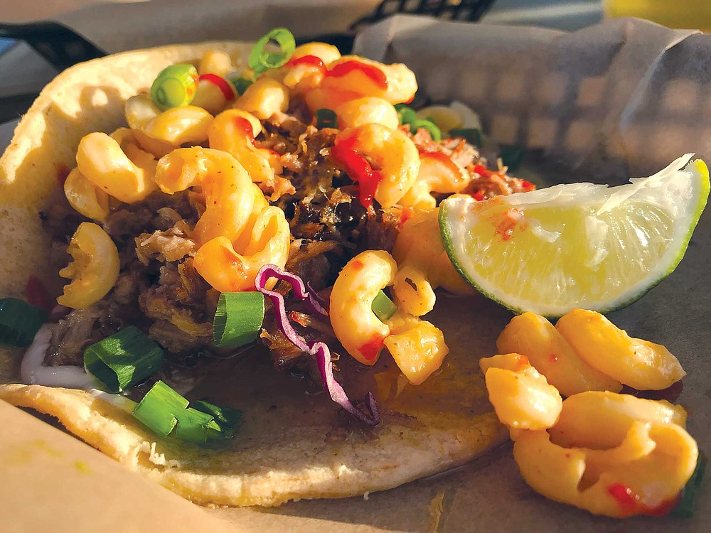 Fusion taco? This one from Carnitas Snack Shack has smoked pulled pork and mac'n cheese.