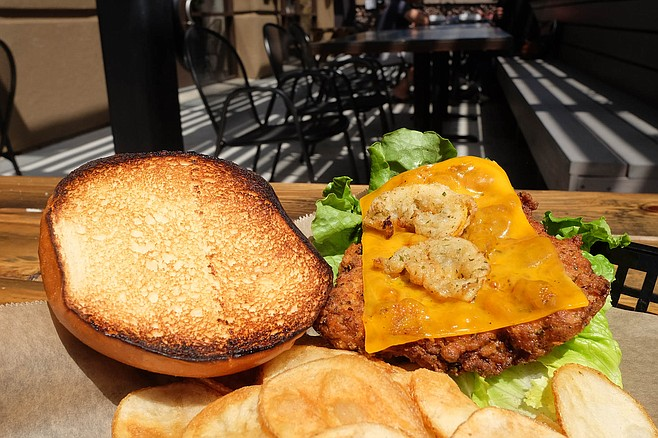 The tang of fried lemon atop a chicken sandwich