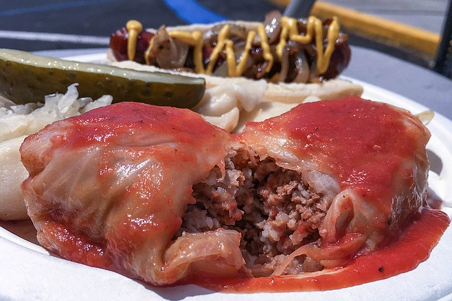 Stuffed cabbage, filled with ground beef, rice, and onions, smothered in tomato sauce