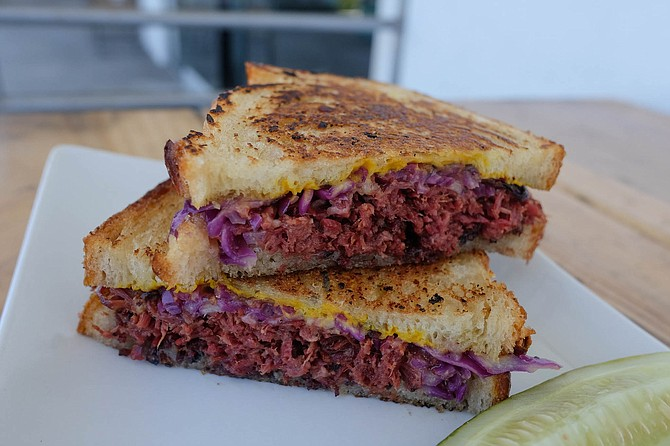 A hot pastrami sandwich, grilled on sourdough