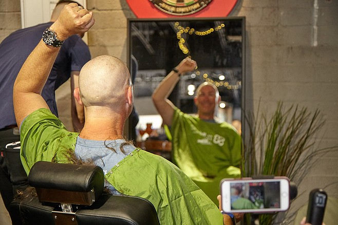 Brewer Mike Hess responds to having his head shaved for charity.