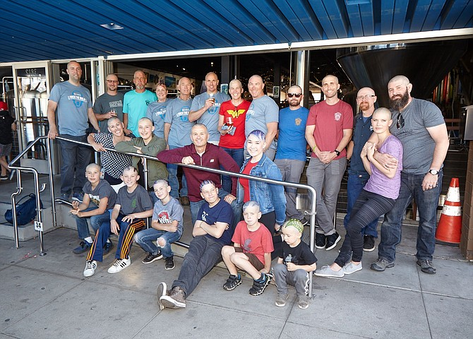Just a few of the freshly shaved heads supporting a St. Baldrick's fundraiser at Mike Hess Brewing in North Park. - Image by Tim  Stahl