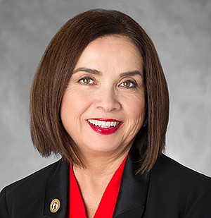 SDSU president Adela de la Torre's $441,504 compensation makes her smile.